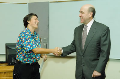 Sereno shaking hands with the provost